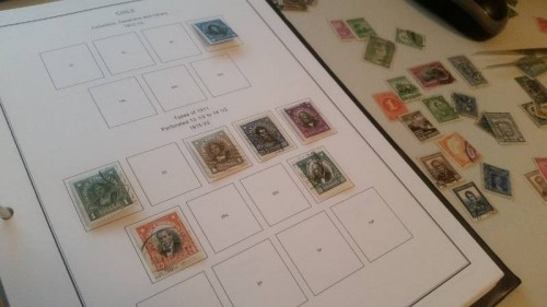 Taking a break from working on this site.  Adding some early 20th century Chile stamps to an album while listening to Mozart.