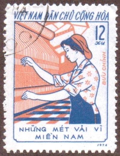 "Stanley Gibbons #: N771 Vietnam #: 821 Description: Female textile worker, Woman weaver Series: Women's ""Three Responsibilities"" movement Face Value: 12 xu's"